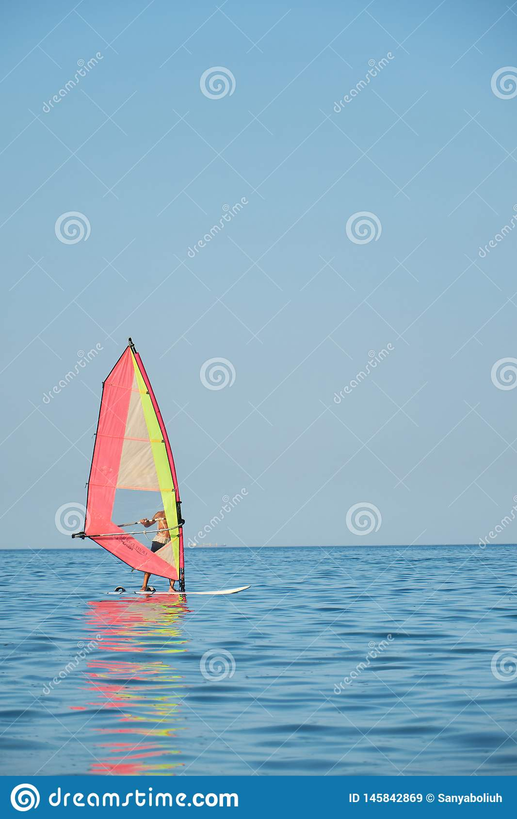 Windsurfing, Fun in the ocean, Extreme Sport on sea background