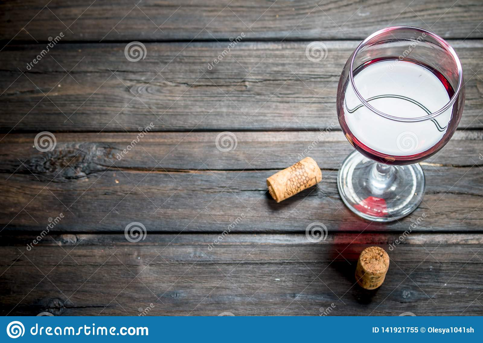 Wine background. A glass of red wine with corks