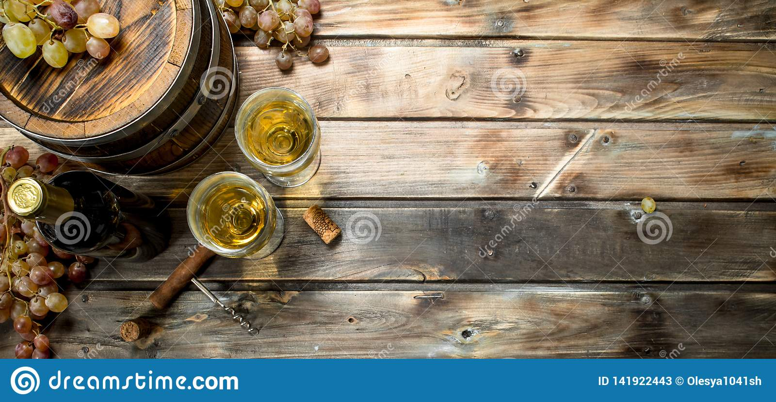 Wine background. White wine in an old barrel
