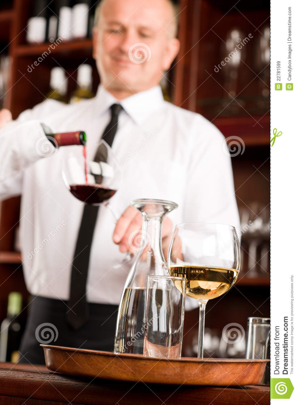 wine bar waiter pour glass in restaurant stock image