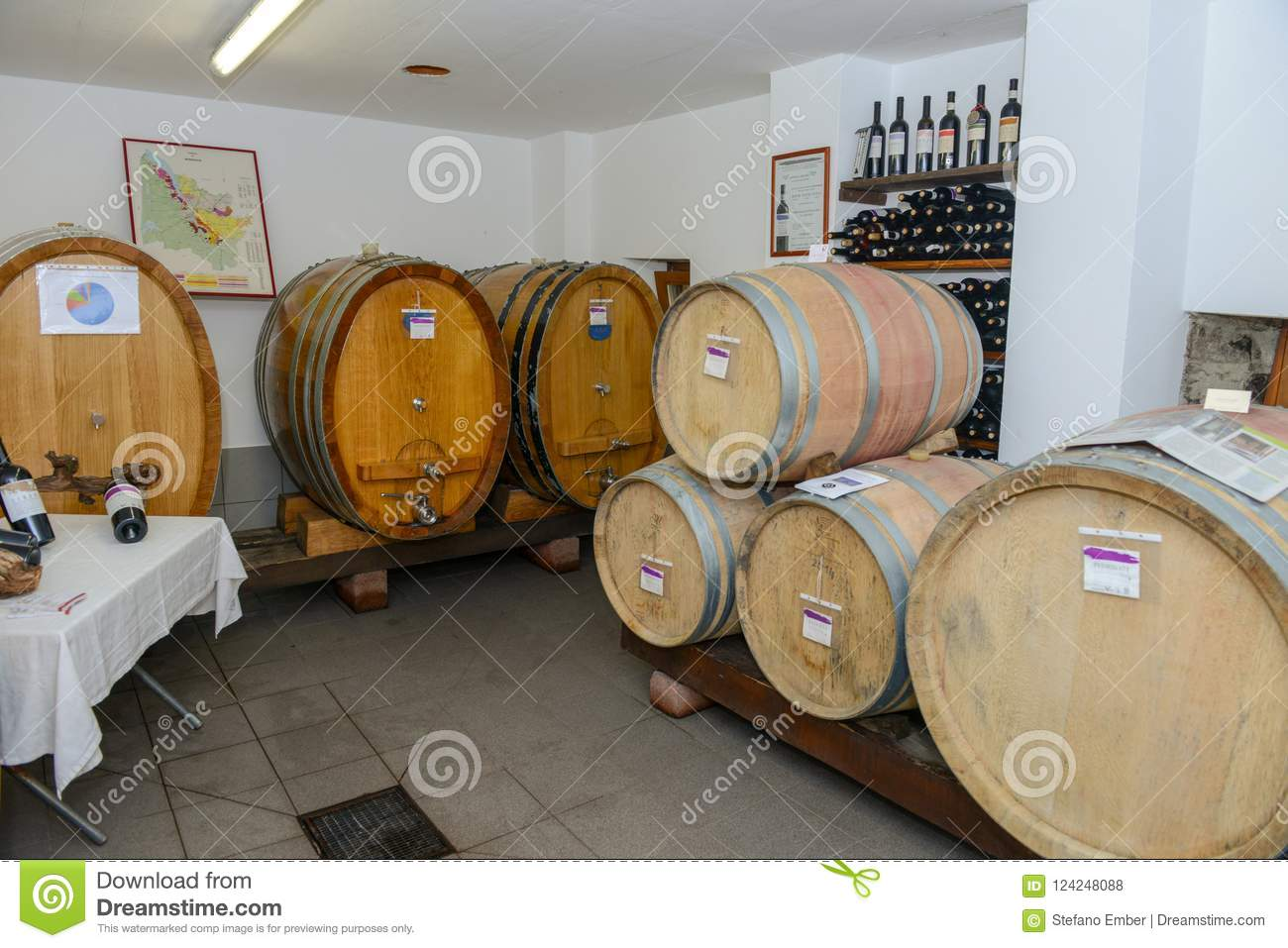 stacked oak barrels maturing red wine. Wine Barrels In Cellar. Cavernous Cellar With Stacked Oak For Maturing Red Wine.