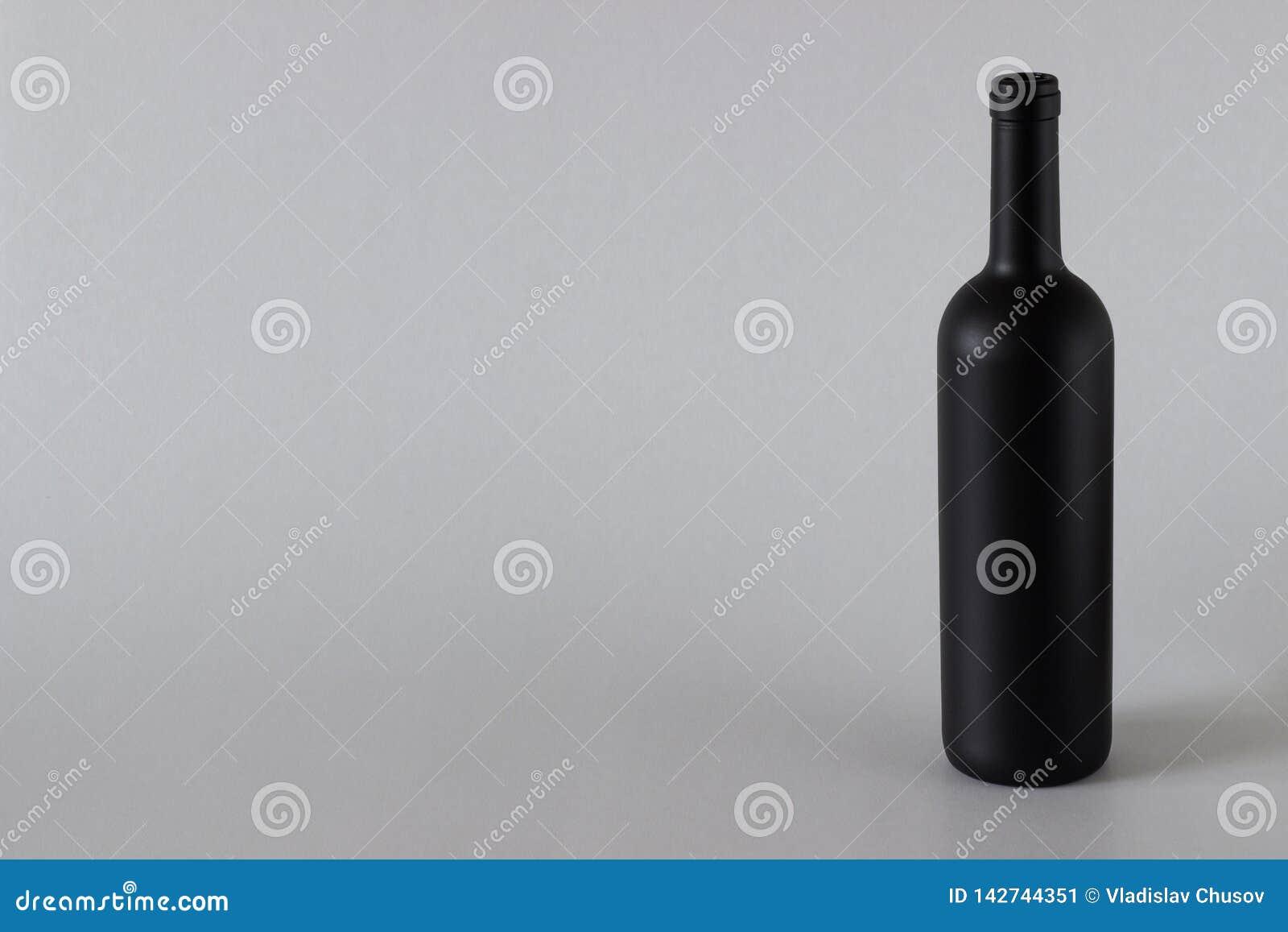 Wine bottle black on a white background.