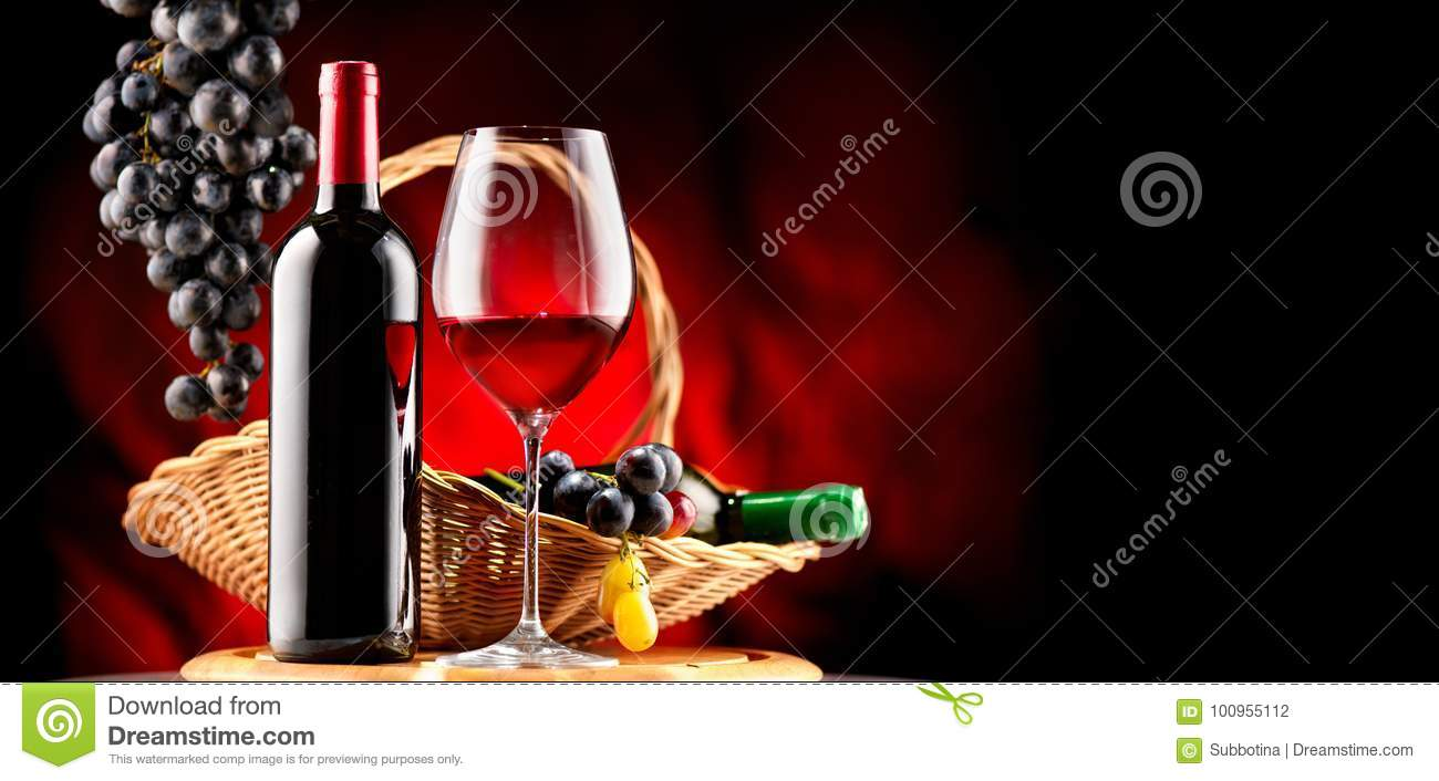 Wine. Bottle and glass of red wine with ripe grapes