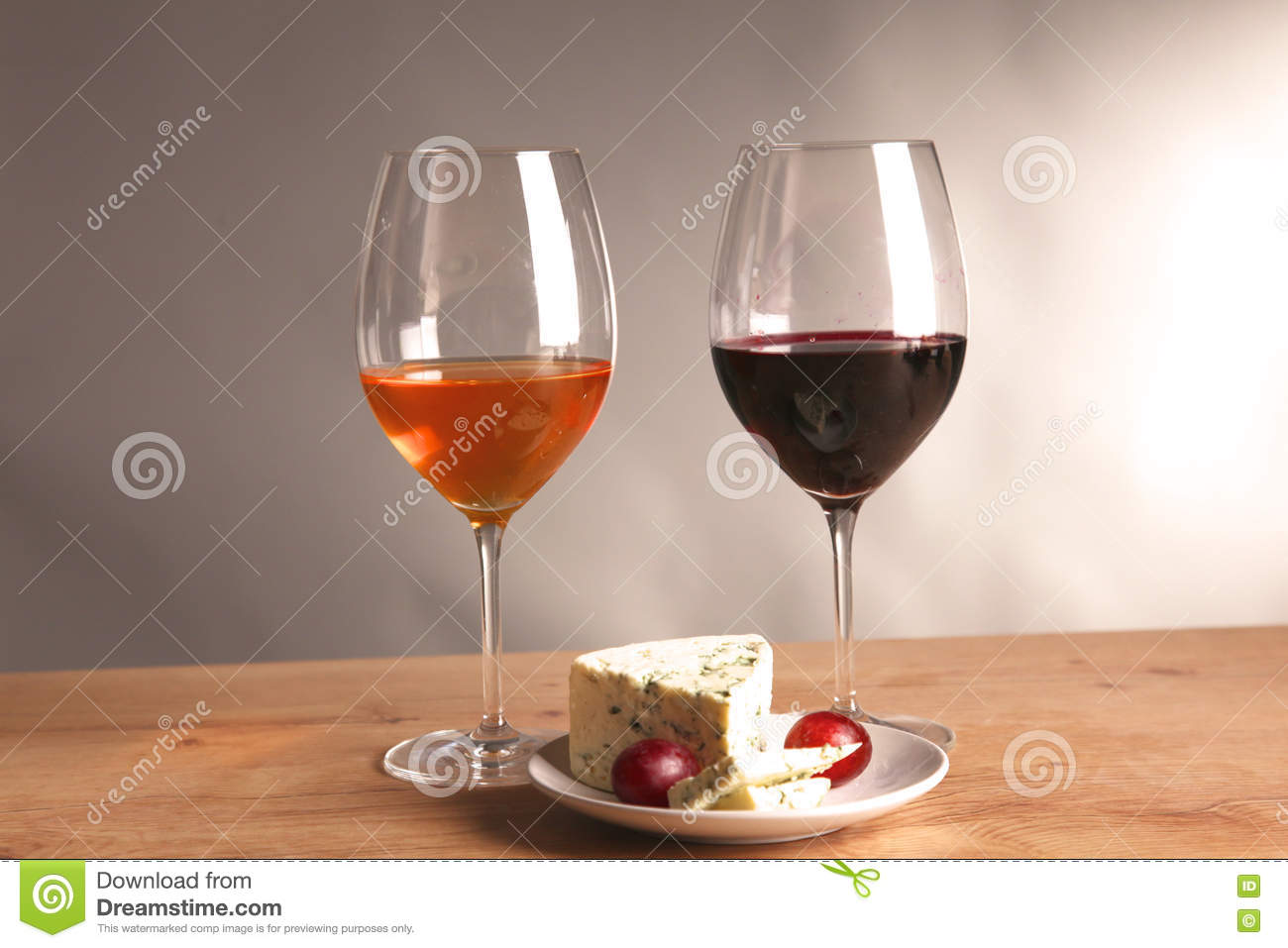 wine bottle and wine glass on a glass table stock photo