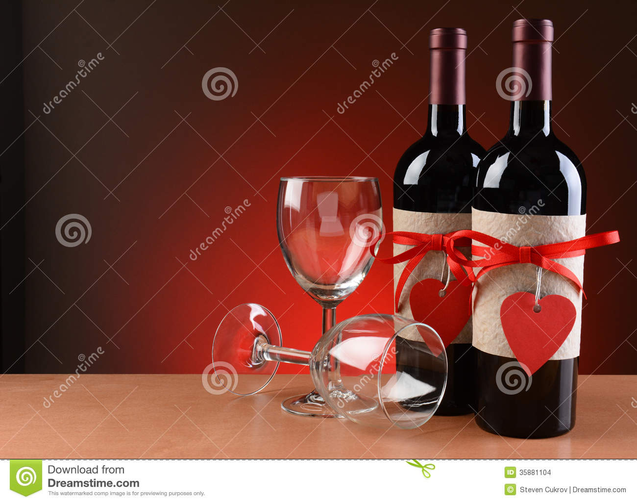 Closeup of a wine bottles decorated for Valentines Day. Two empty ...