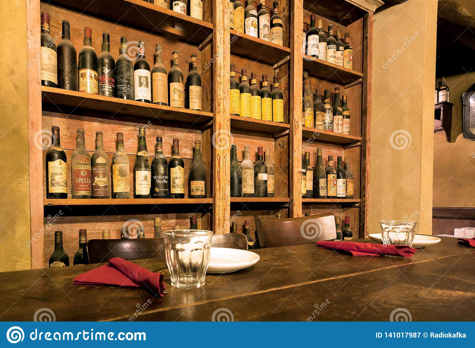 Wine Bottles Waiting For Visitors Of The Traditional Italian Restaurant With Wooden Tables Nice Decor Editorial Photography Image Of People Italy 141017987