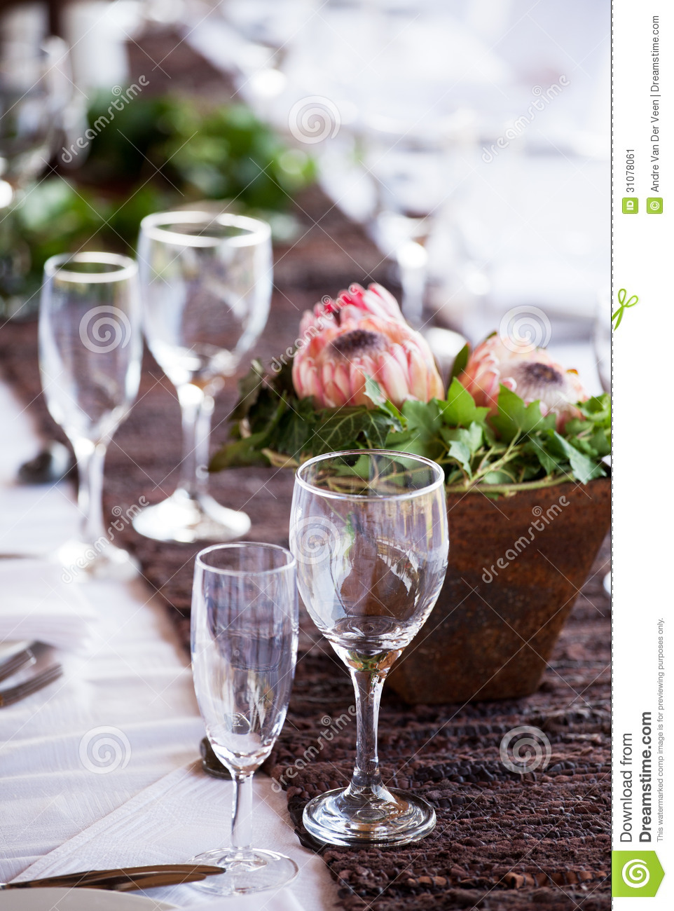 Wine And Champagne Glasses On A Table With Protea Flowers