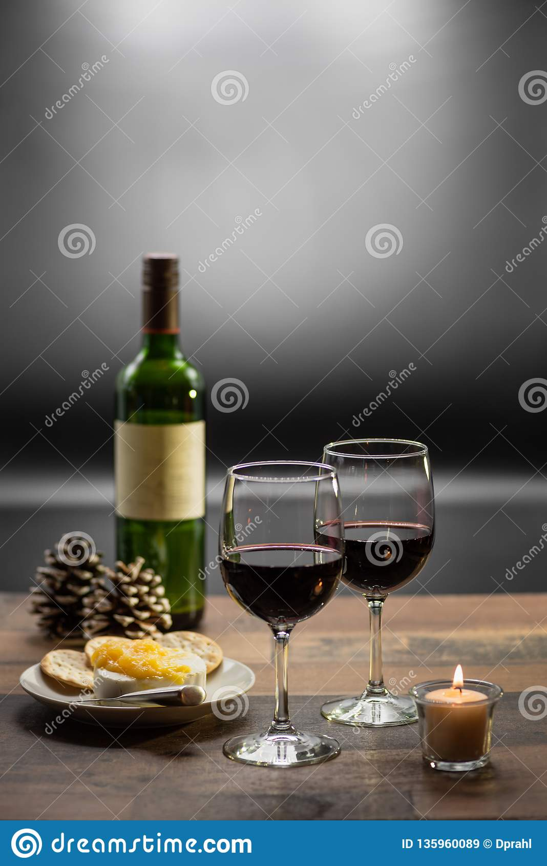 wine and cheese by candlelight
