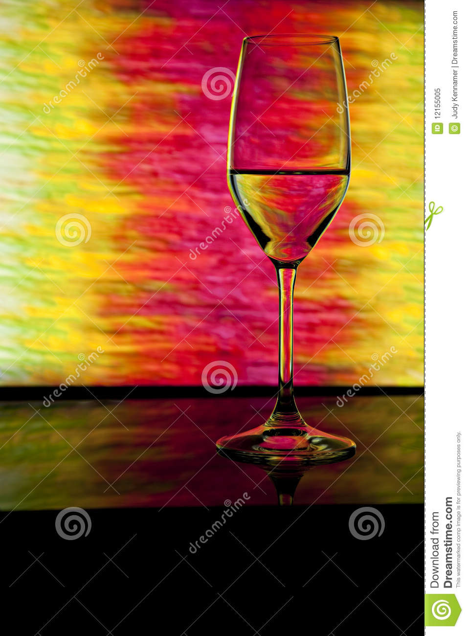 Wine glass in front of colorful background