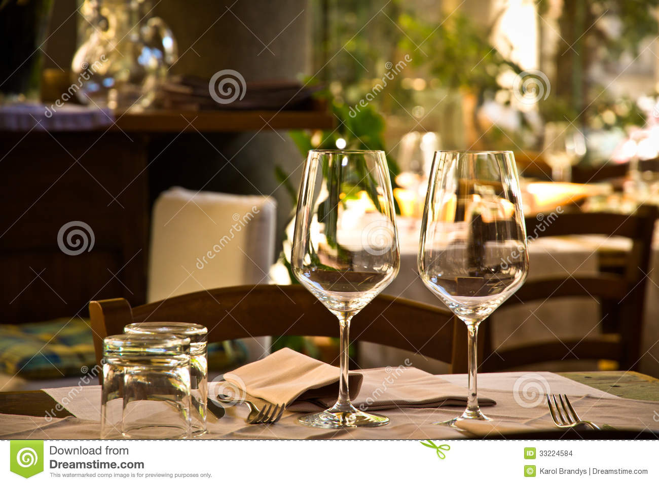 Wine glasses and table setting in restaurant stock photo for Table for two