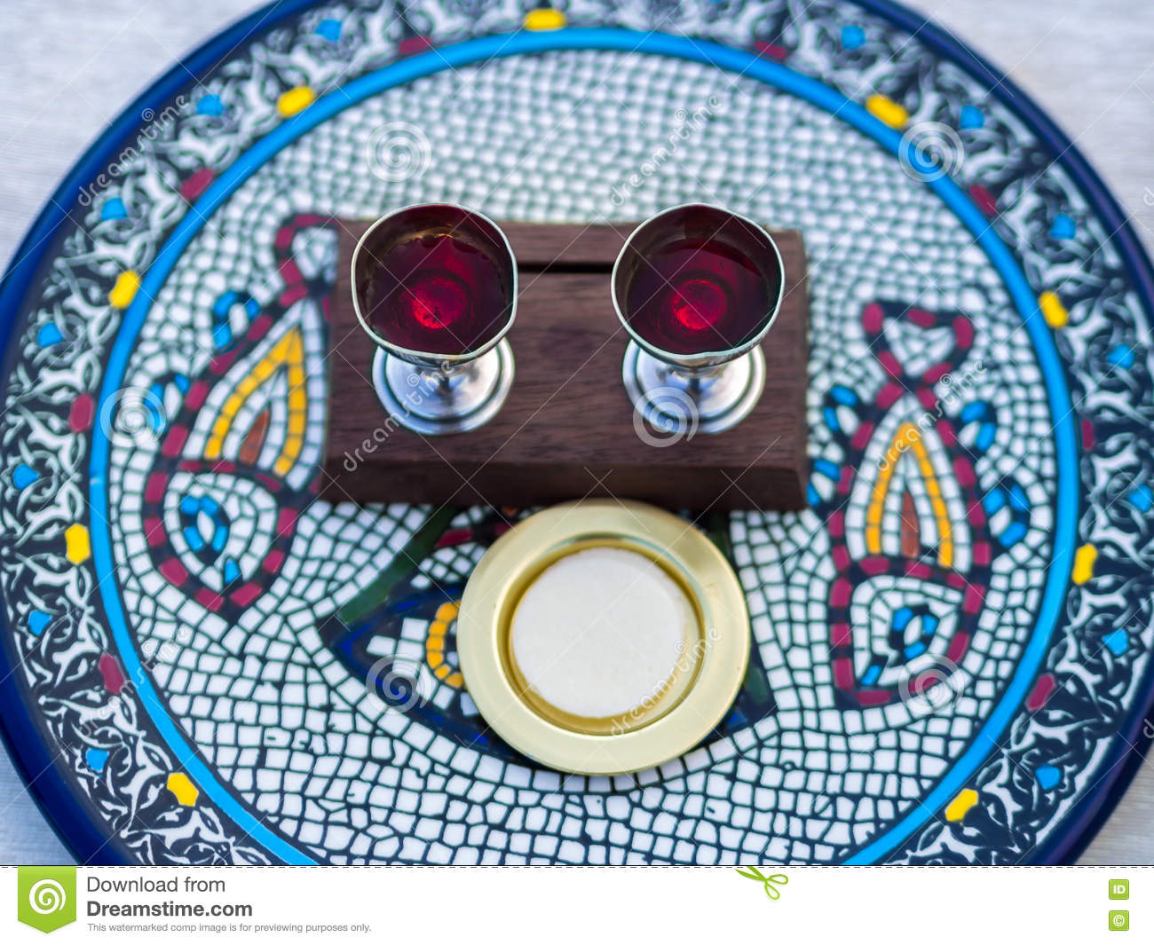 Wine and Host (Sacramental Bread) on Ceramic Plate