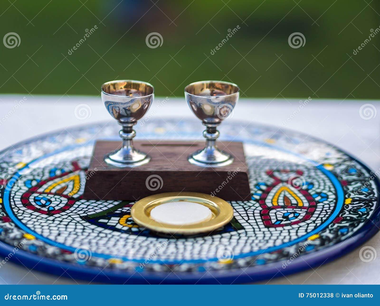 Wine and Host (Sacramental Bread) on Ceramic Plate