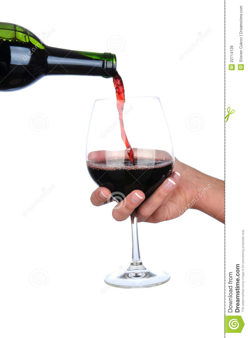 Wine Pouring Into A Glass Held By Womans Hand Stock Photo ...