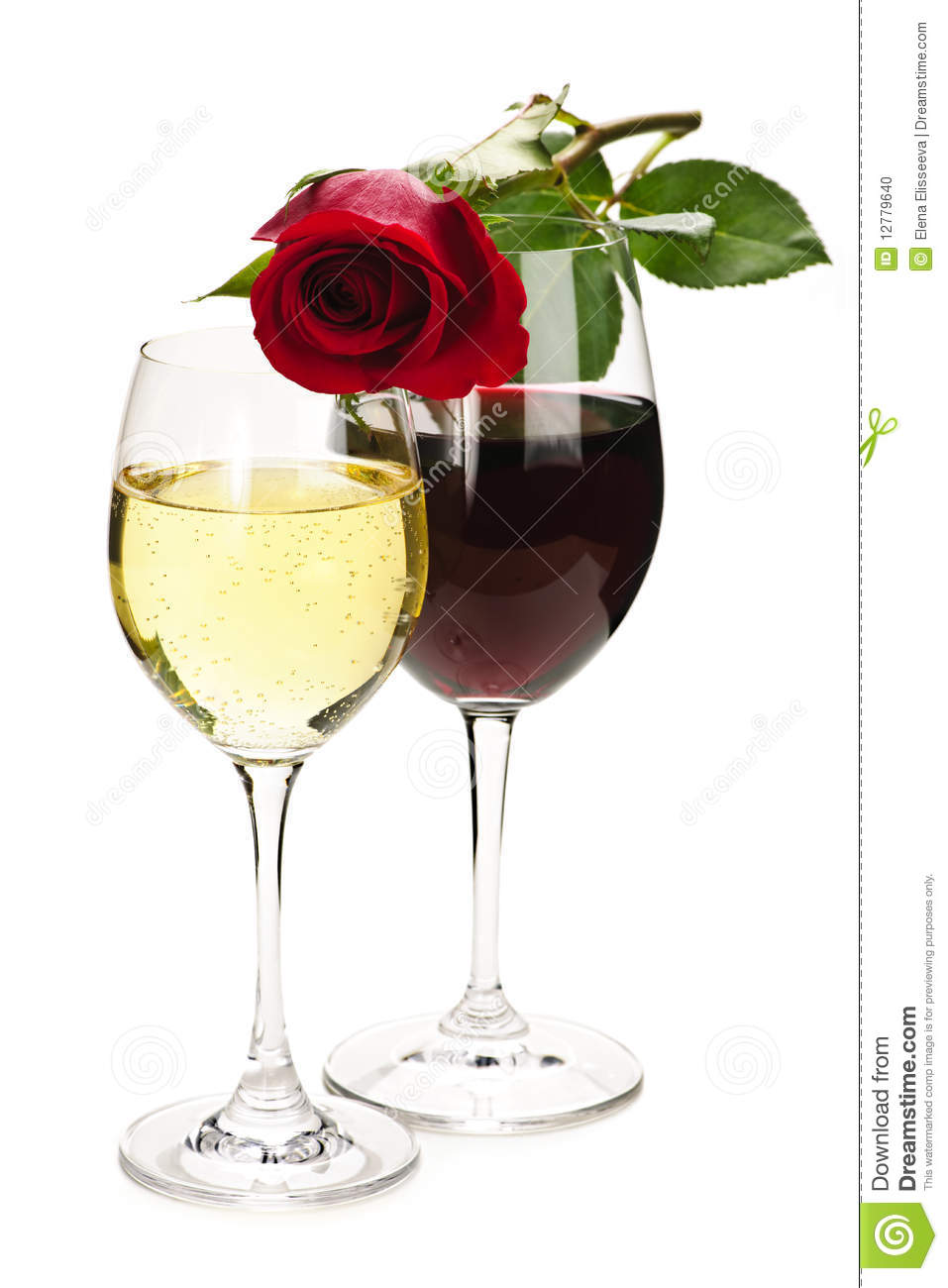 Romantic rose on top of red and white wine glasses isolated on white ...
