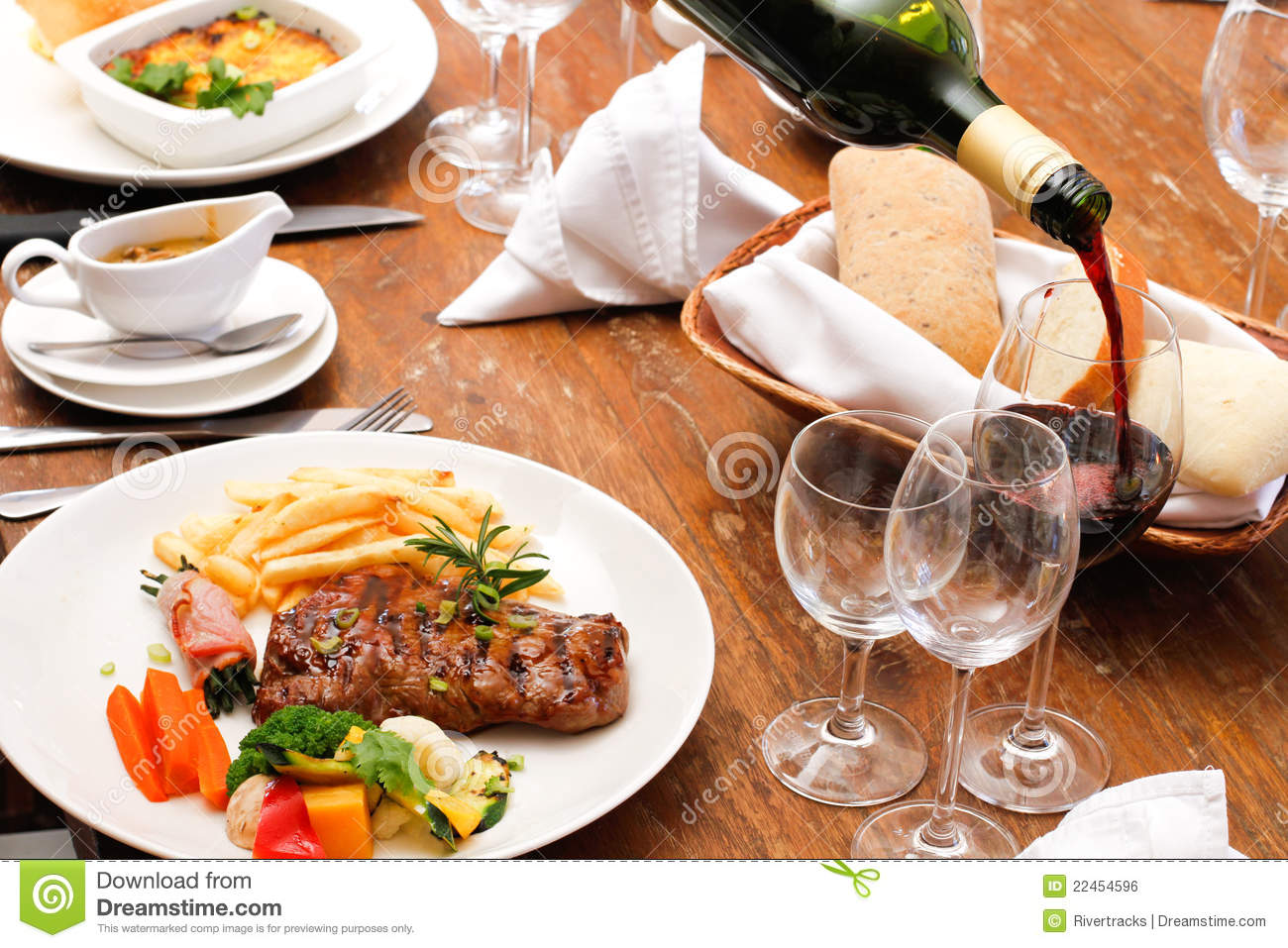 Wine with restaurant food plate