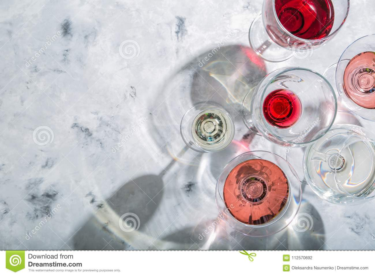 Wine tasting concept - glass with different wine on marble background