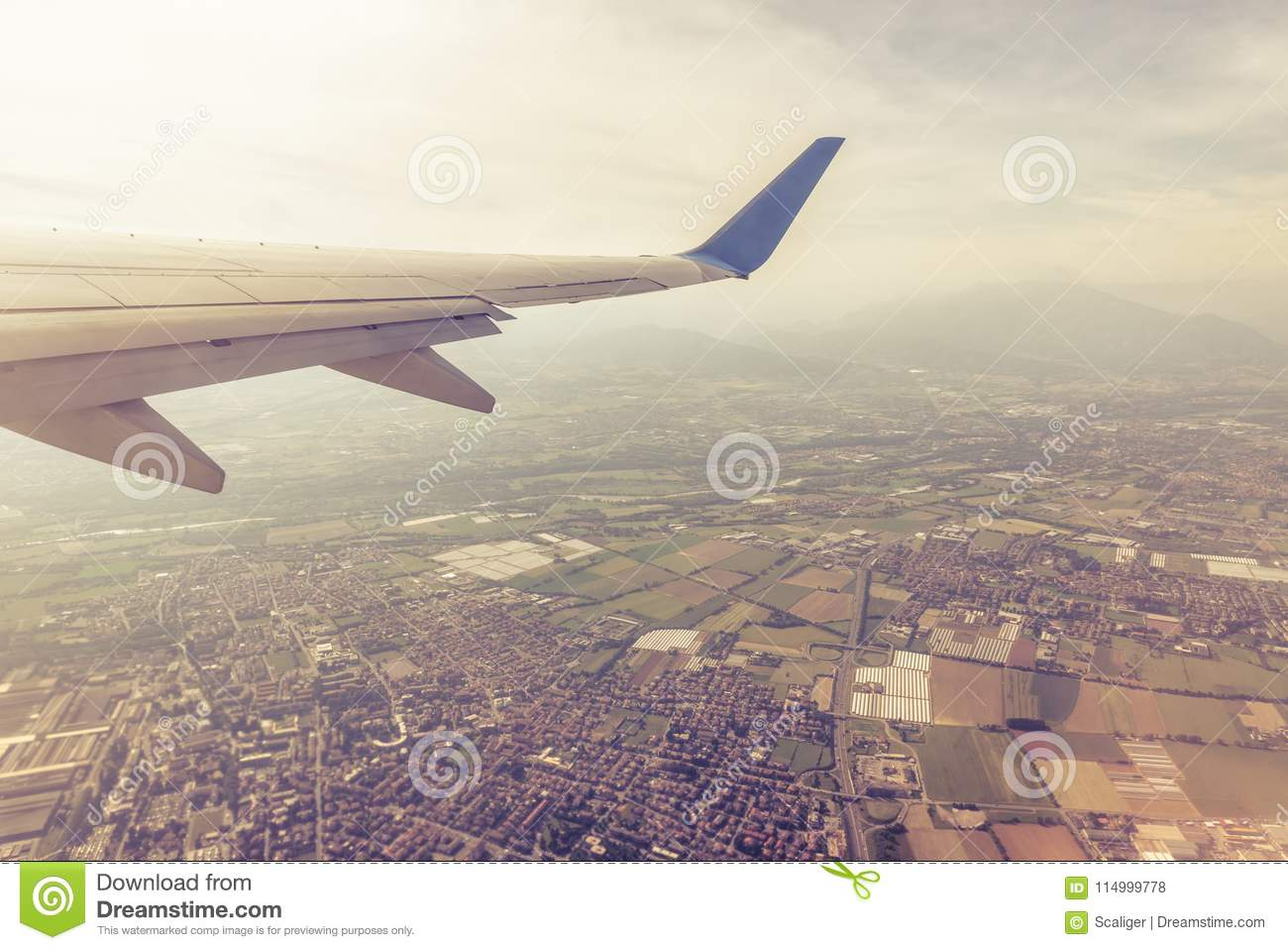 Download Wing Of An Airplane Flying Above Towns And Villages Stock Photo - Image of altitude, airplane: 114999778