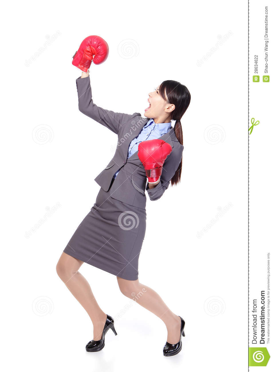 Winning business woman wearing boxing gloves
