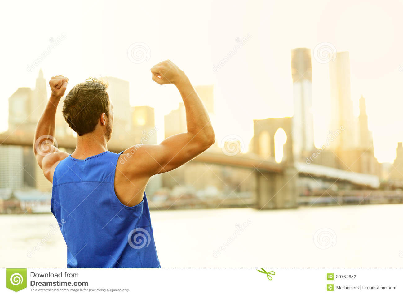 Fitness Man Showing Muscles Cheering Outside Royalty Free