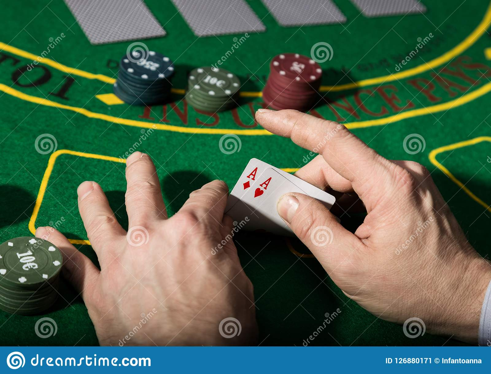 Winning combination in poker game. Cards and chips on a green cloth