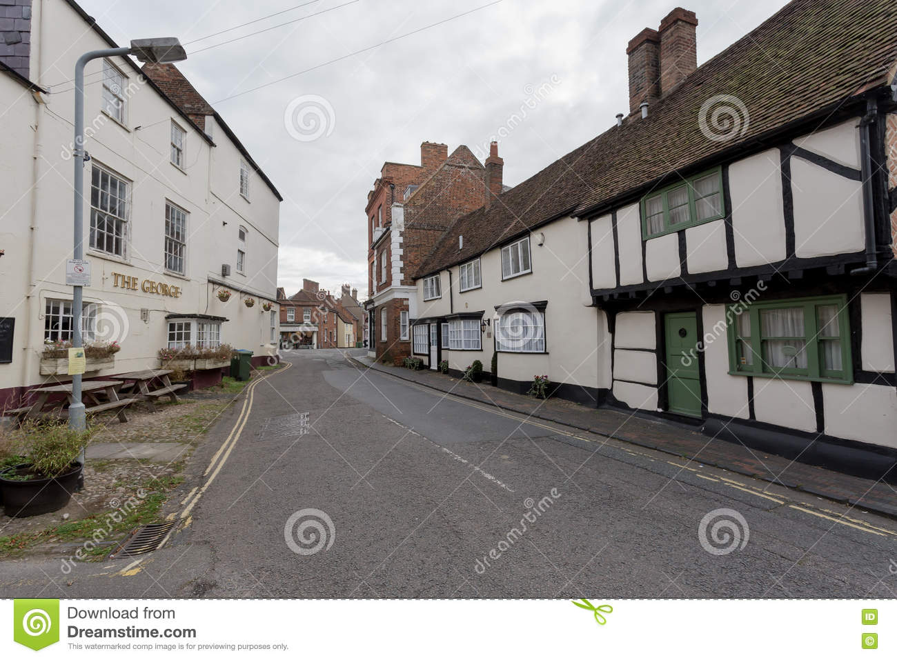 Winslow, Buckinghamshire, United Kingdom, October 25, 2016: Cottages and Pub The George Winslow on the Horn street on grey chilly