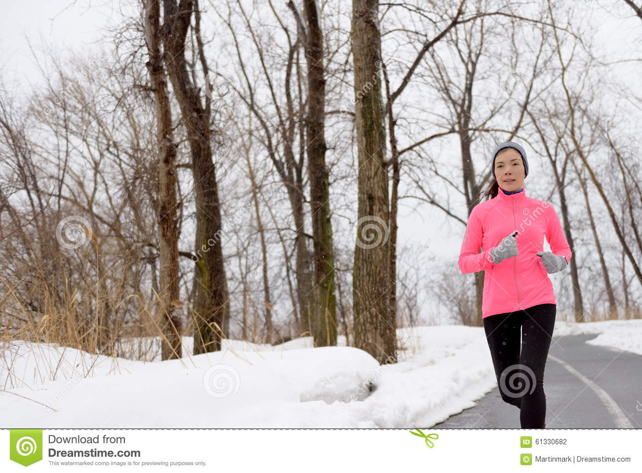 Winter cardio exercise - woman jogging running