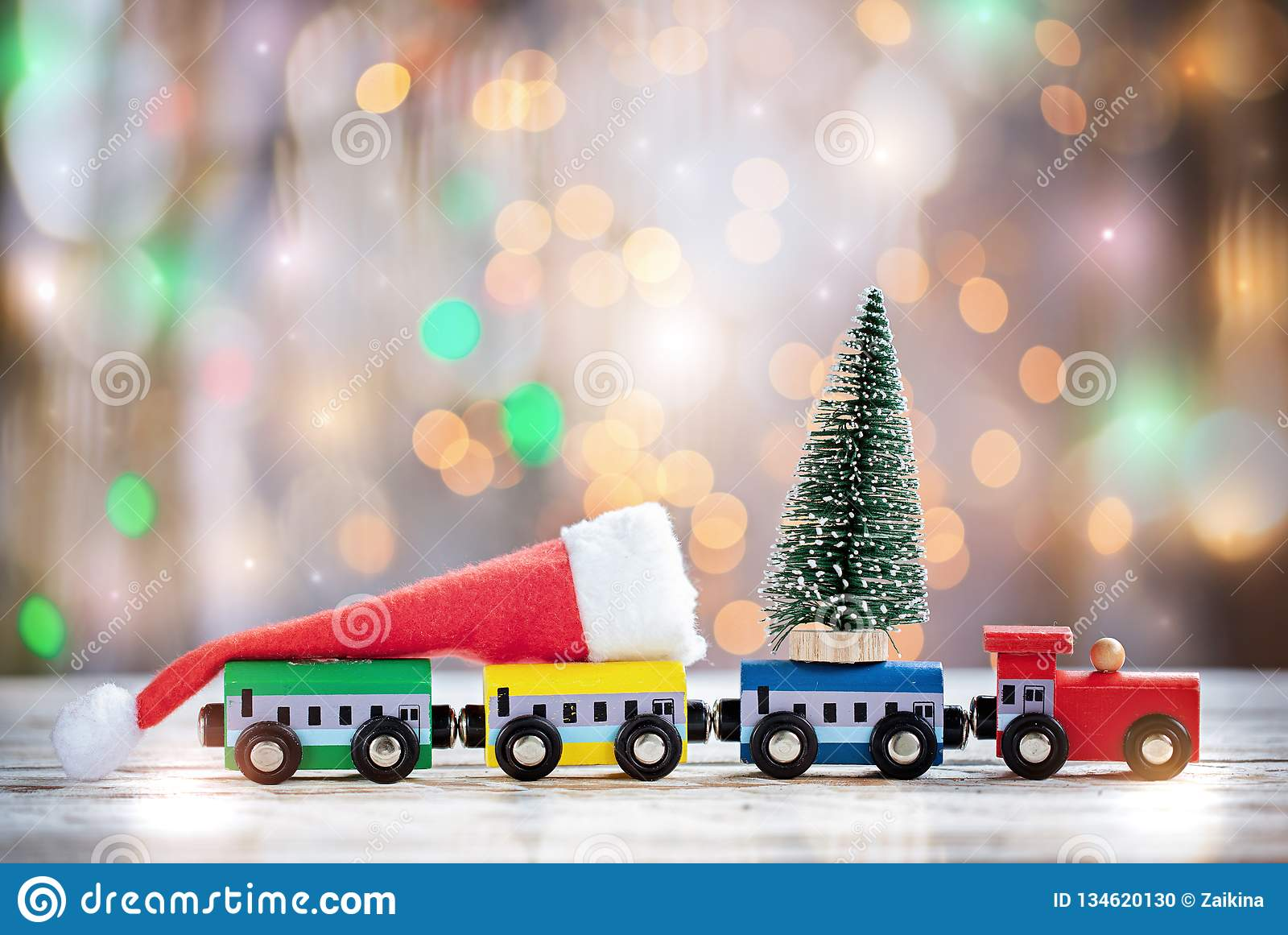 Winter Christmas background Miniature colorful train with fir tree. Holiday greeting card