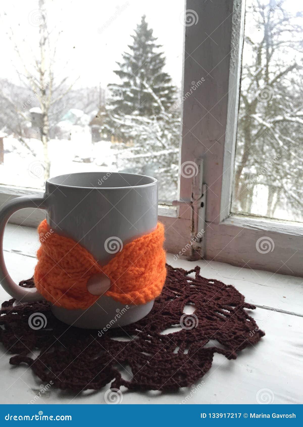 Winter cosiness: white ceramic mug of tea or coffee