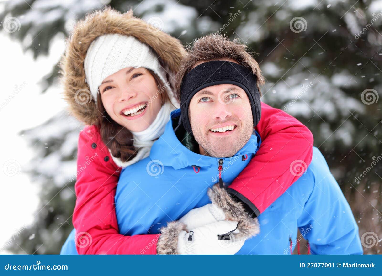 Winter couple happy piggyback