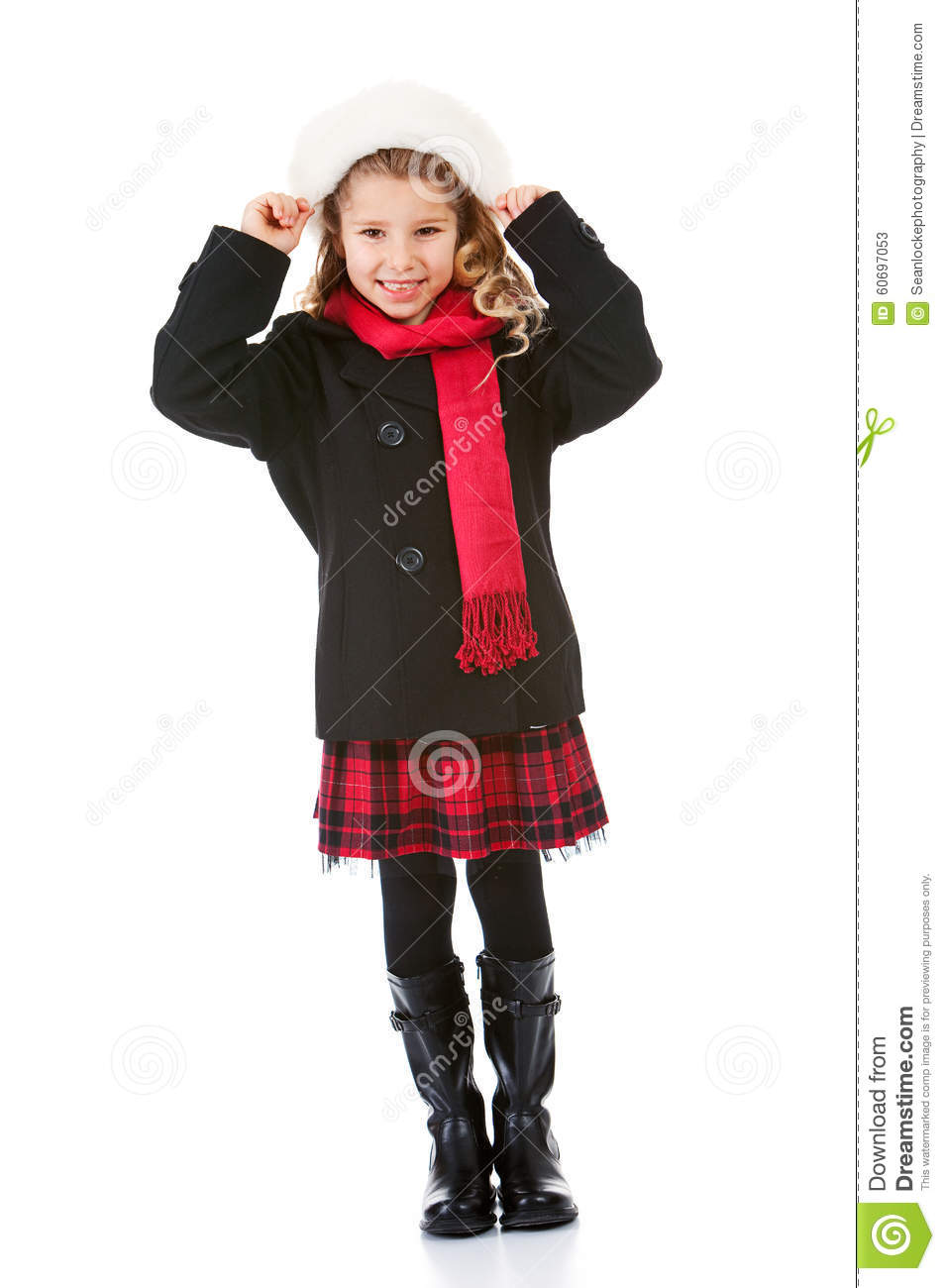 Cute little girl dressed in winter clothing appropriate for christmas