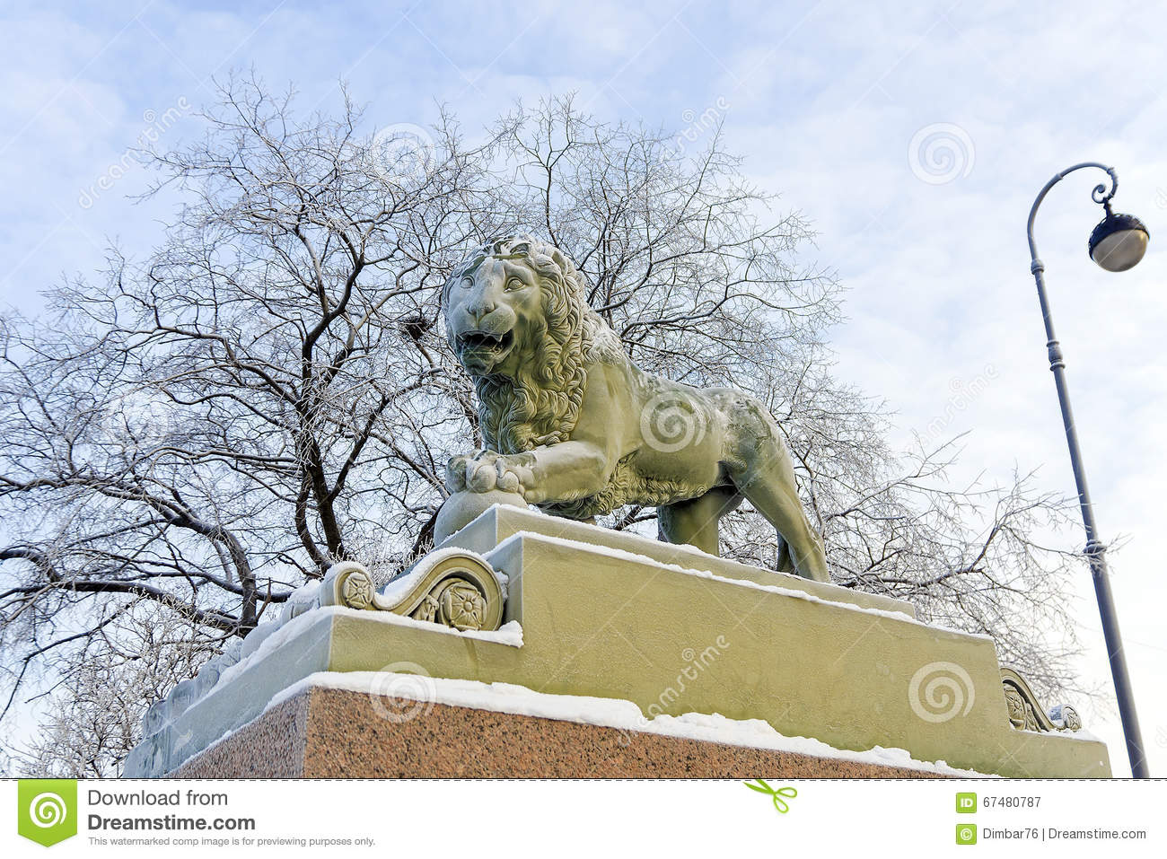 Winter embankment of the Neva River, snow lion statues