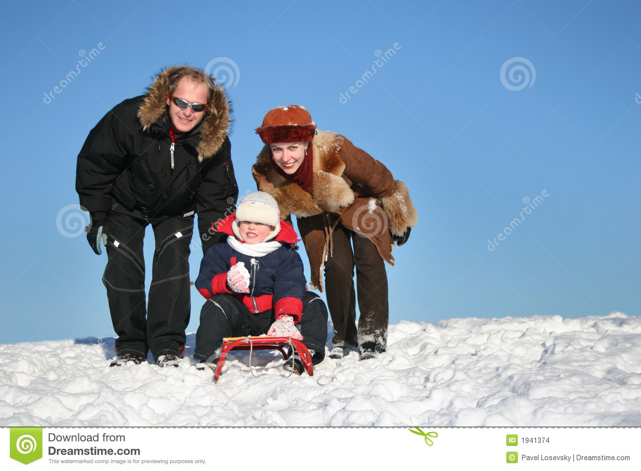 Winter family with sled