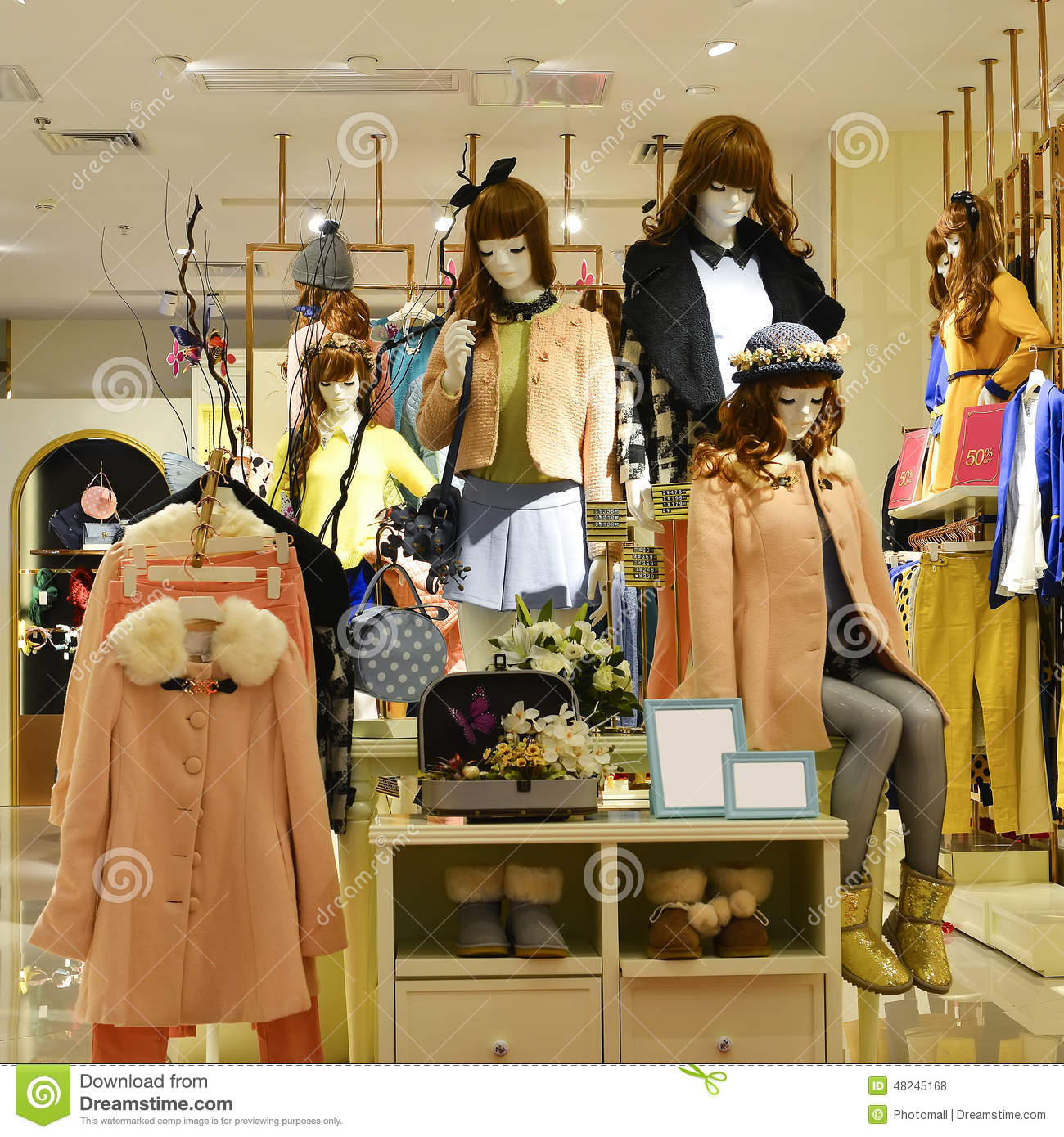 Winter Fashion Mannequins In Fashion Shop Window Stock ...