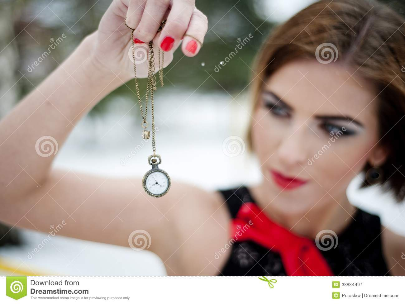 Fashion portrait of interesting woman in snow