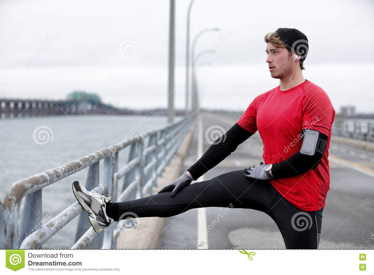 Winter fitness running man warm-up stretching legs