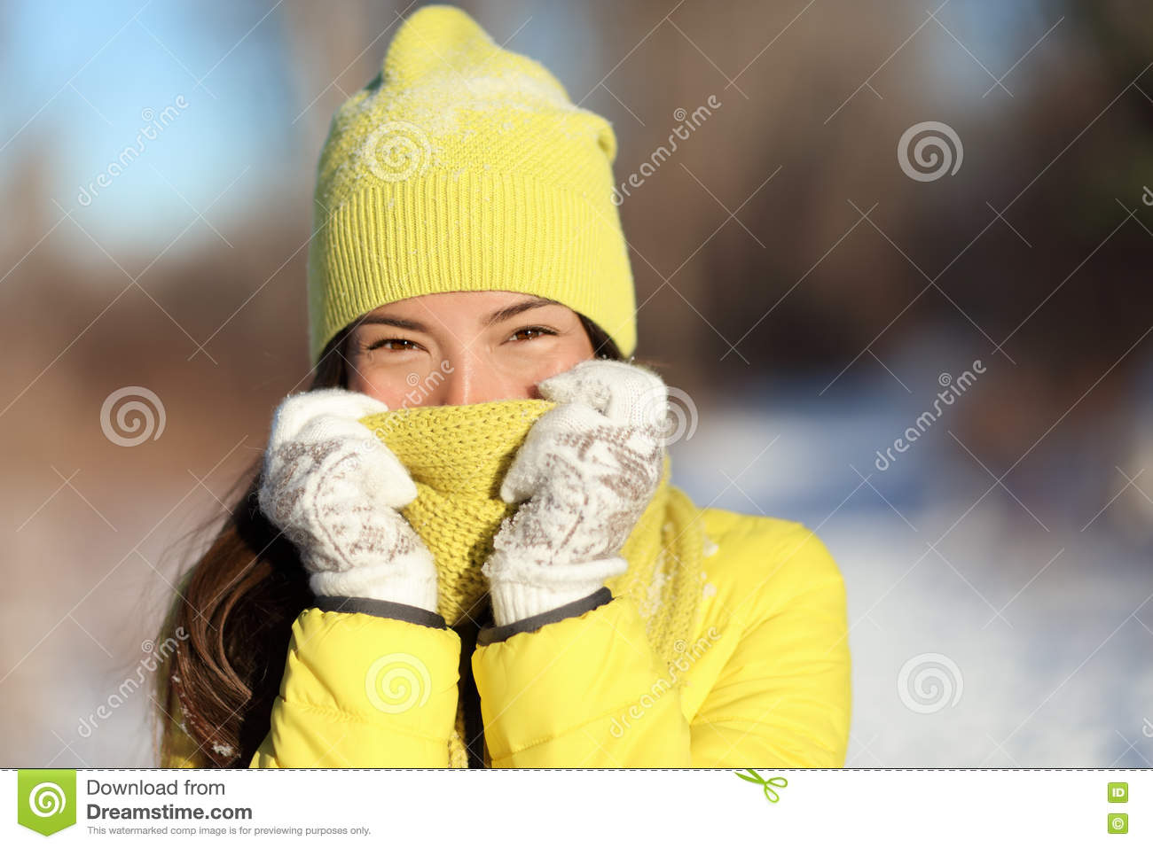 Winter freezing woman covering face from cold