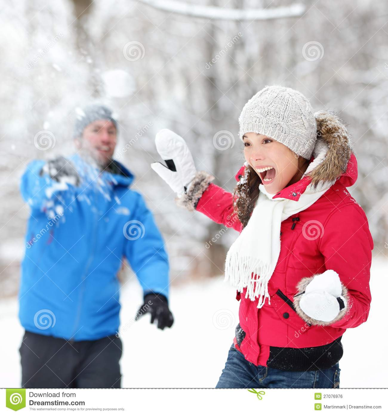 Couple In Snowball Fight Stock Photo