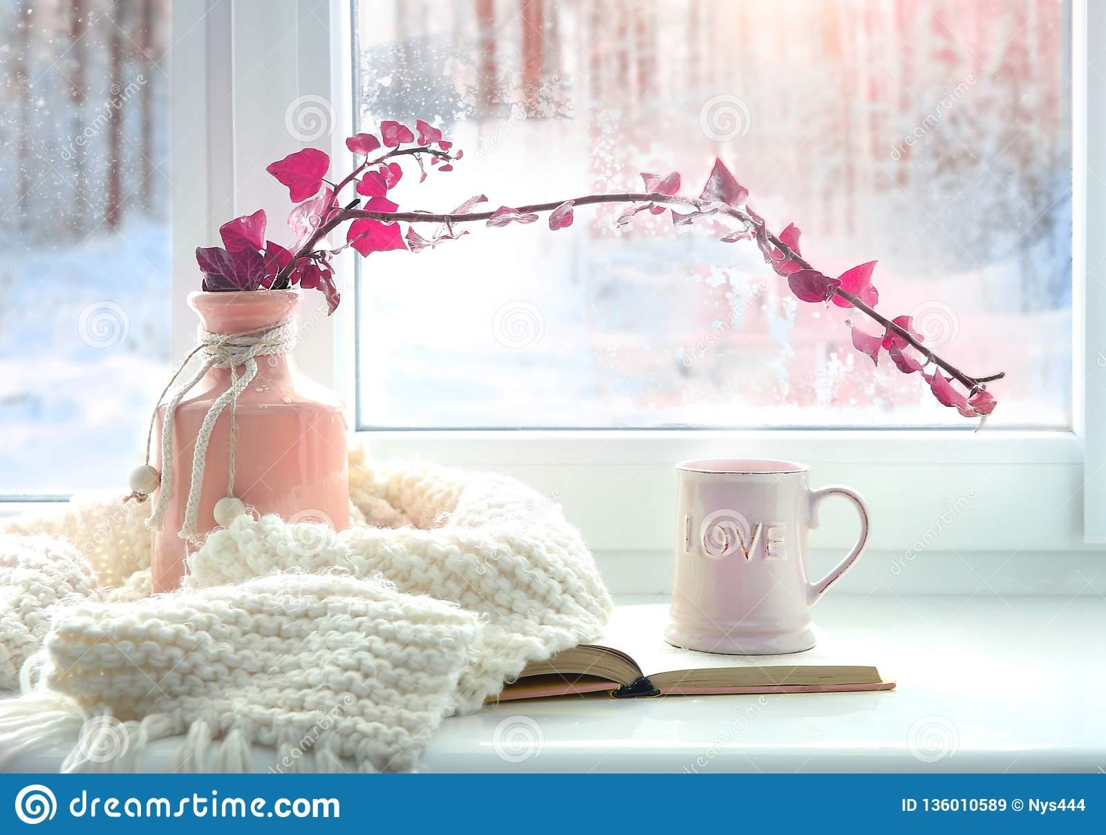 Winter home romantic icon.Valentine card.Mug with knits and book on window sill