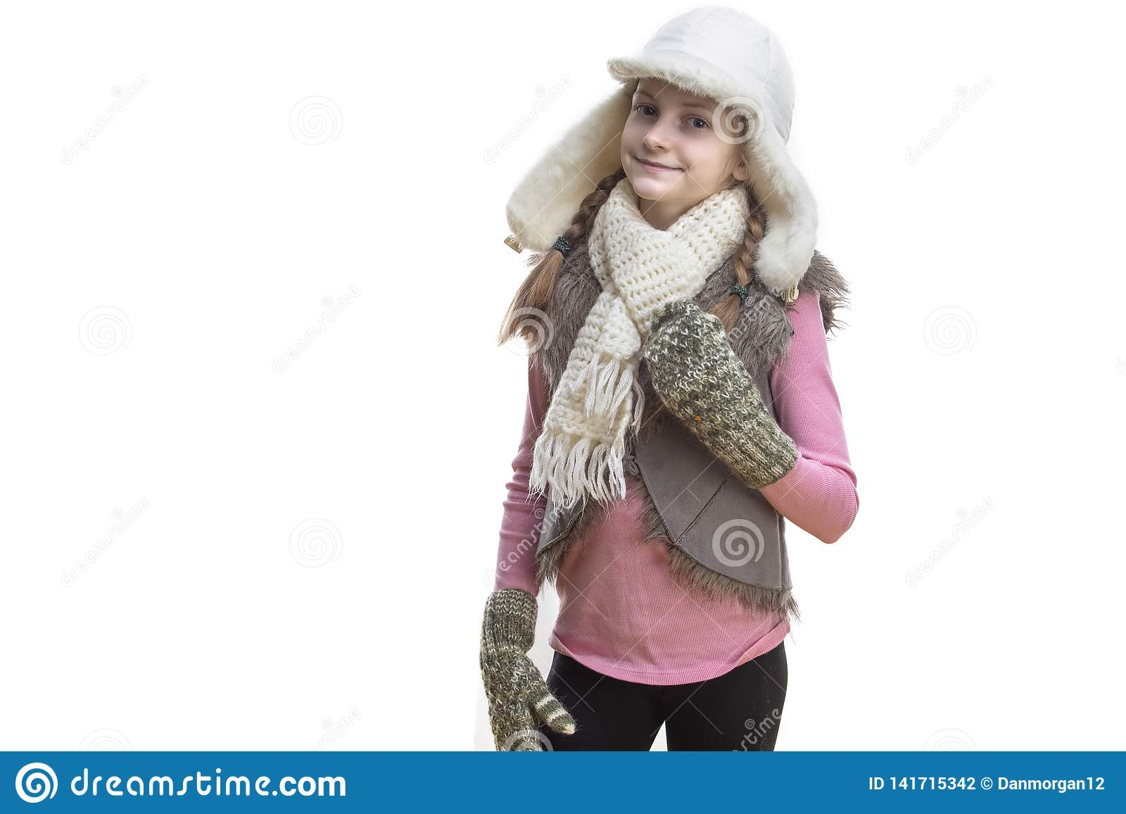 a8c3183f49e Winter Kids Fashion And Holidays Ideas. Smiling Caucasian Girl In Pink Vest  and White Winter Hat