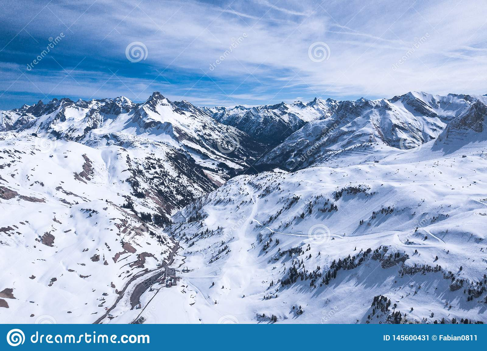 Winter landscape with blue sky in austria by drone