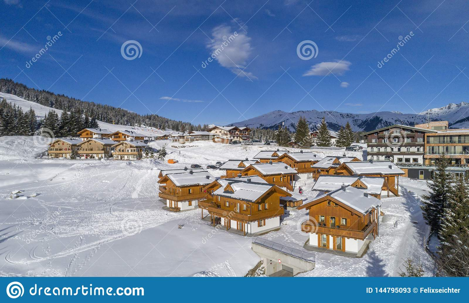 Winter landscape, forest and little village in mountain