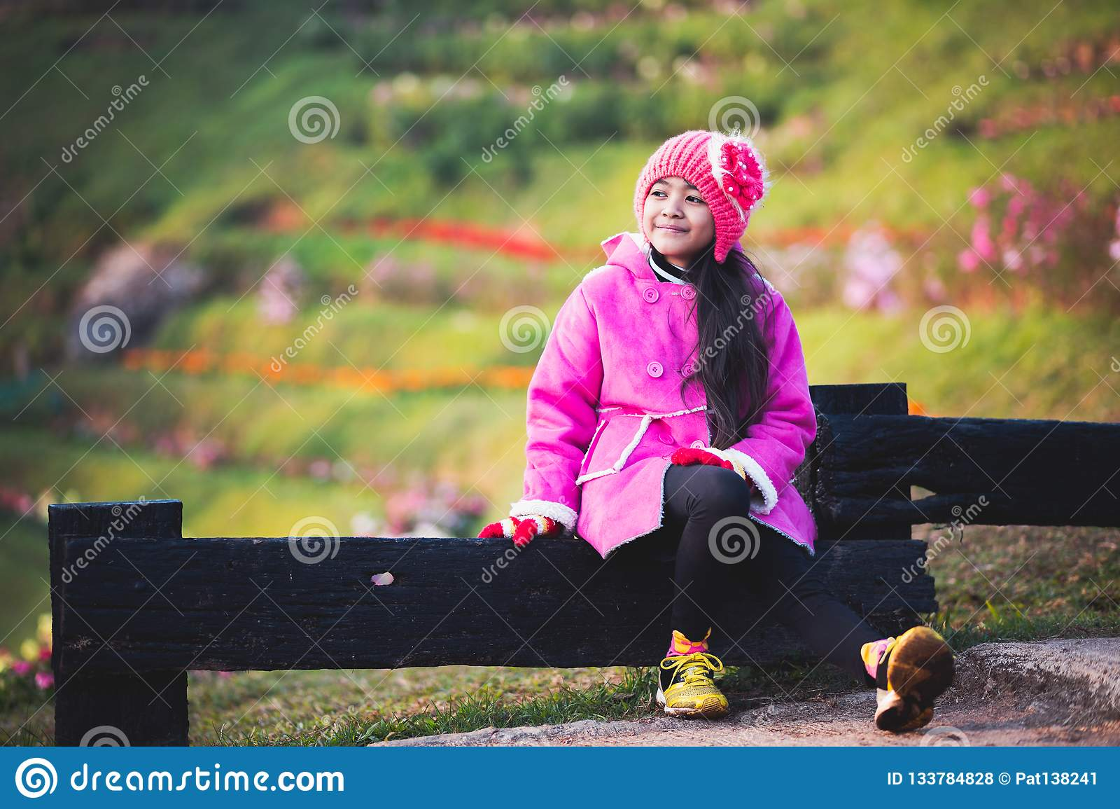 Little girl wearing clothes in winter day