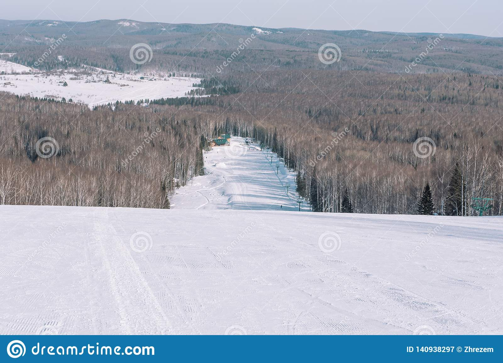 Winter mountain view from above. View down from the mountain in winter. Winter landscape. Winter in Siberia