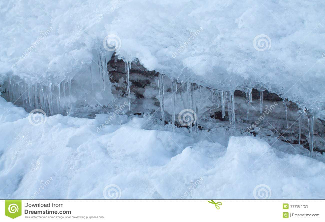 Winter nature background, icicles in the snow
