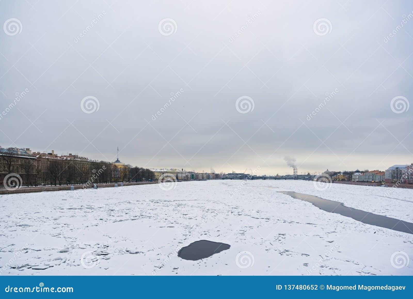 Winter on Neva river. Saint Petersburg, Russia. View on Admiralty embankment and Annuncuation bridge. Horizontal shot stock photography