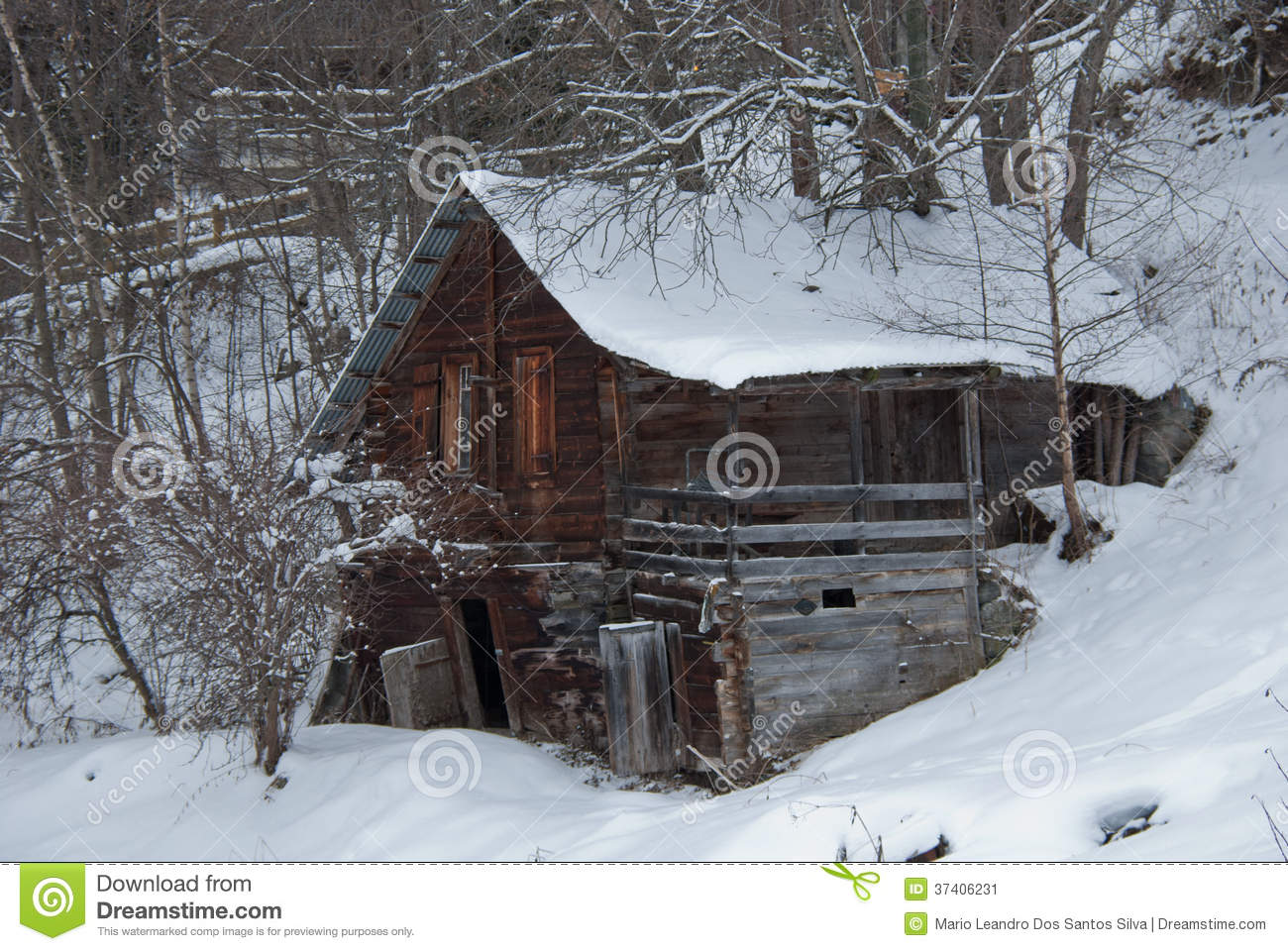 Winter Old And Abandoned Log Cabin In The Alps Stock Image