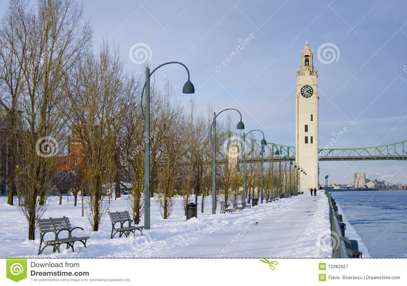 Royalty Free Stock Photography: Winter park by river clock tower snow ...