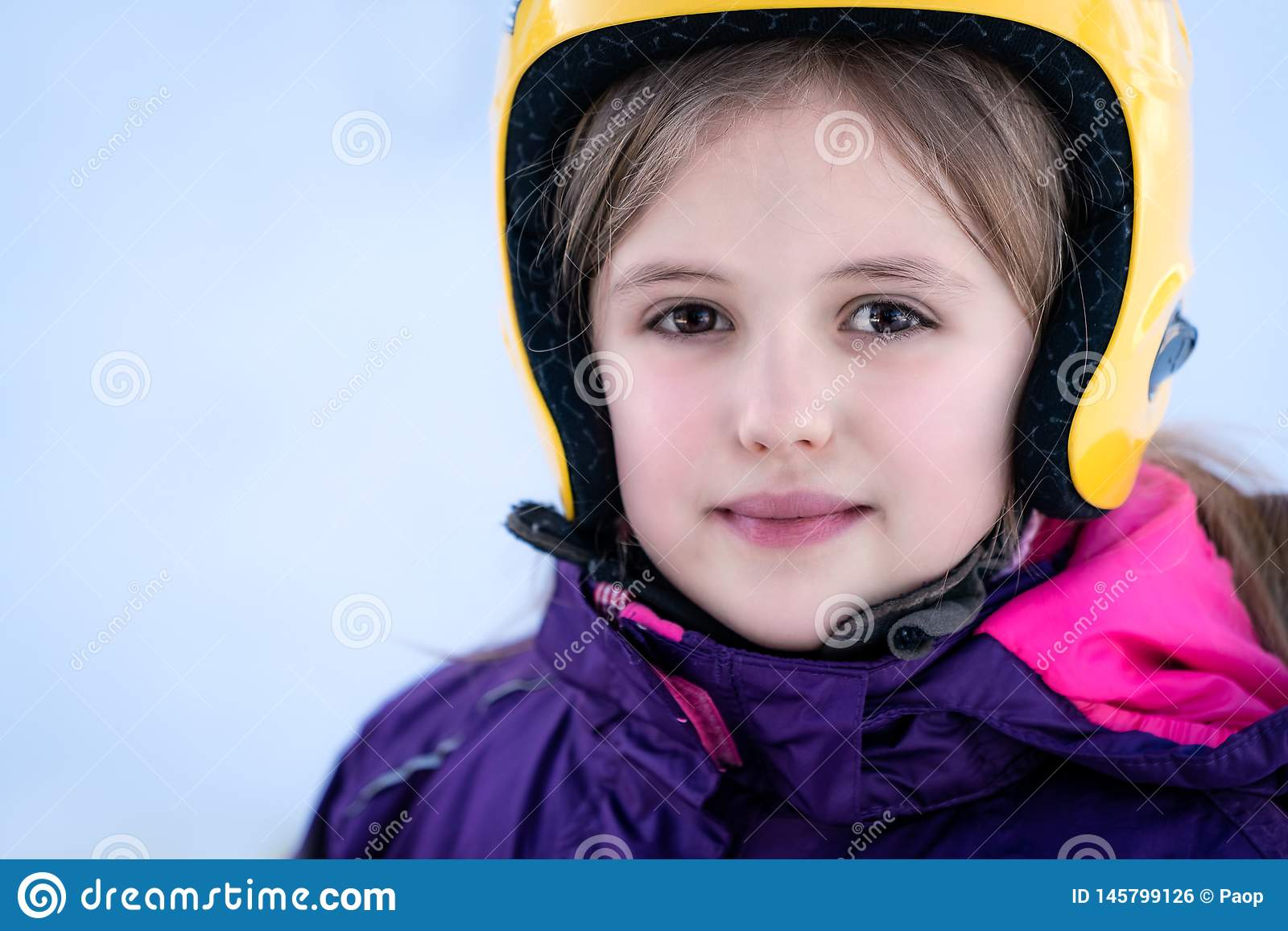 Young skier girl winter portrait