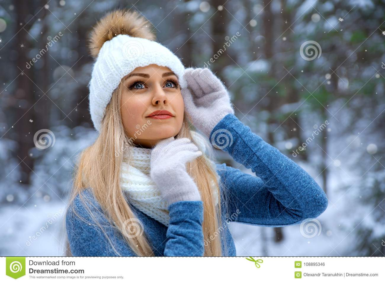Beautiful blonde girl in red hat and gloves