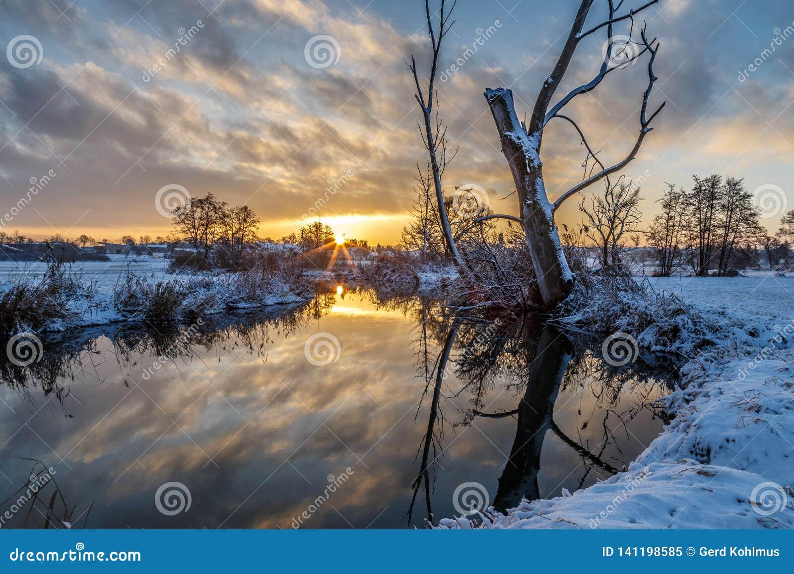 Winter scene: sunrise at the river